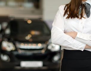Representative female in car dealership salon.