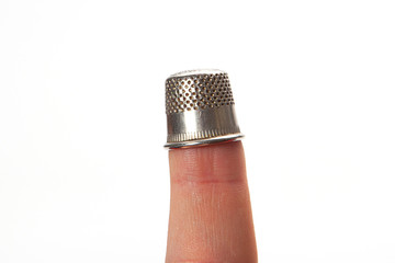 Thimble on middle finger, closeup