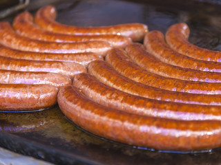 Budapest, Hungary, Fair. Hungarian sausages fried in a pan