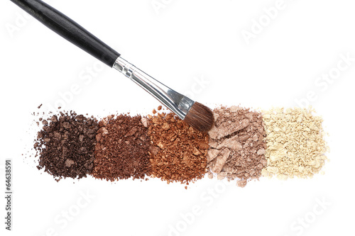 Crushed eyeshadow and professional make-up brush isolated