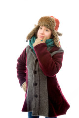Young woman in warm clothing and thinking