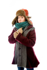 Young woman in warm clothing and shivering in cold
