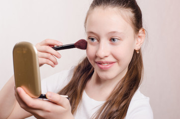 Girl twelve years with pleasure face powders
