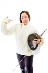 Female fencer pointing with holding a mask and sword