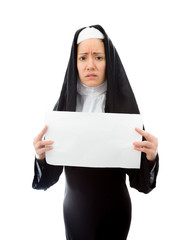 Young nun showing a blank placard