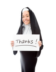 Young nun showing thanks sign on white background