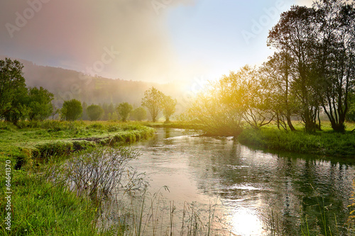 canvas print picture Sunrise on a smal river with fog