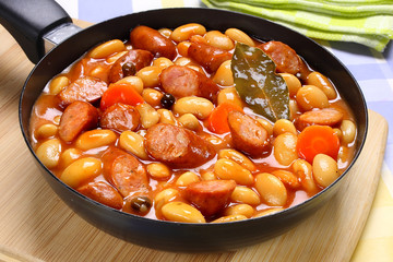 Beans with tomato sauce and sausage