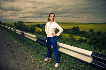 sportive woman at stormy roadside