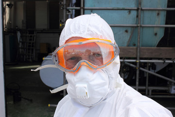 Industrial Cleaner wearing his full ppe for a boiler clean