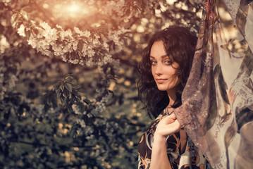pretty brunet portrait at cherry tree