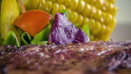 T-bone steak with grilled corn