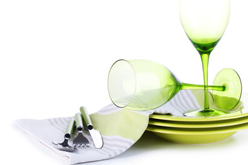 Green table settings, isolated white