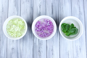 Aromatherapy treatment bowls with flowers and perfumed water