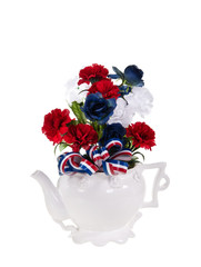 Patriotic, red, white, and blue, flower arrangement on white