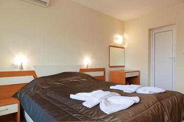 Interior Design: small bedroom in a hotel.