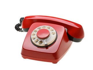 Vintage red phone isolated on a white background