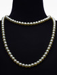 necklace type pearl on black mannequin isolated on white - 64647926