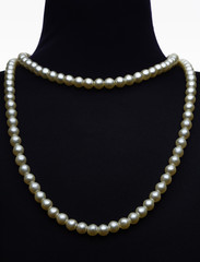 necklace type pearl on black mannequin isolated on white