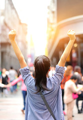 cheering woman open arms at street