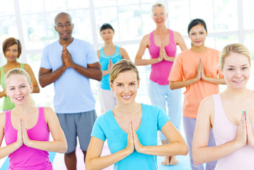 Group Of Happy Multi-Ethnic People In A Yoga Class