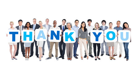 Group Of Business People Holding Word Thank You