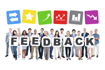 Group Of Business People Holding The Word Feedback