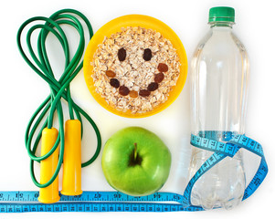 Bottle of water, muesli and green apple. Attributes of a healthy