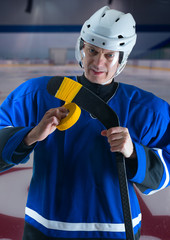 Hockey player taping his stick
