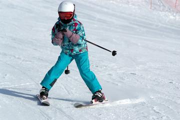 Teenage girl in mountain ski