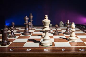 White chess king under siege.