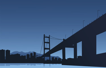 The big city and the bridge on a blue background
