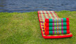 Foldable corrugated triangular pillow to rest near water - 64654907