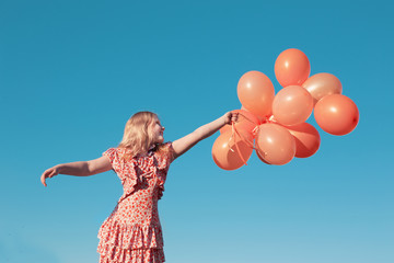 happy little girl  outdoors with balloons