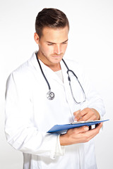 Portait of young male doctor with stethoscope and clipboard