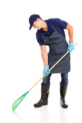 gardener raking on white background