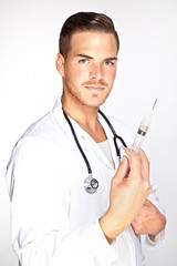 Portrait of young male doctor holding syringe with injection