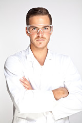 Portait of young male lab assistant with protective glasses