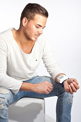Portrait of young man measuring his blood pressure