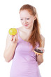 Woman choosing between fruits and sweets