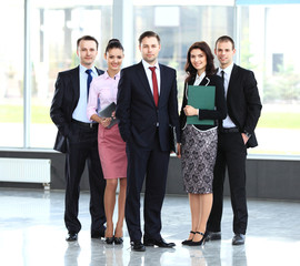 Group portrait of professional business team looking confidently