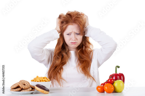 Girl trying to decide what to eat
