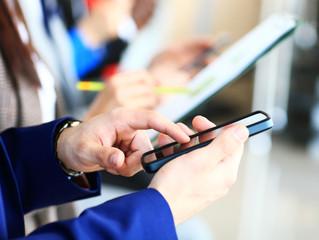Businessman using modern smartphone or mobile phone