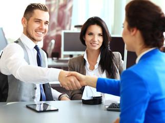 Business handshake. Business people shaking hands