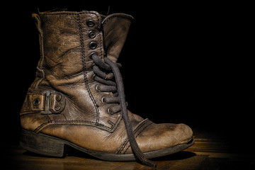Old boot on the dark background.