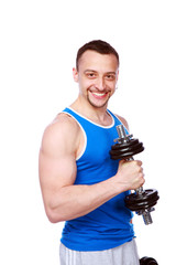 Happy muscular man working out with dumbbells