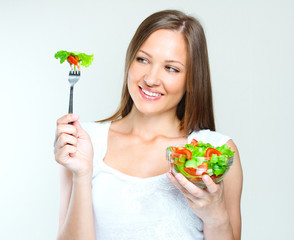 woman eating salad with vegetables. healthy food.