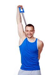 Happy sportsman doing fitness exercises with expander