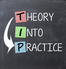 Theory into practice text on a blackboard