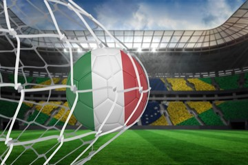 Football in italy colours at back of net